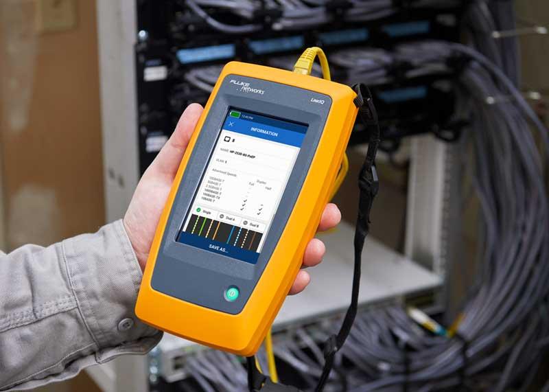 Technician Holds a Fluke Networks' LinkIQ Cable + Network Tester