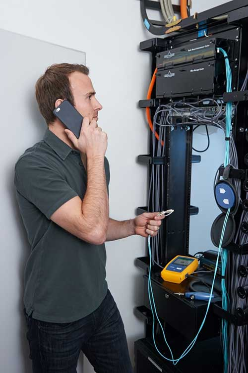 Technician Uses OptiFiber Pro® to Test Network